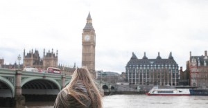young woman looking over Big Ben whilst on her UK Gap Year