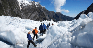 Group-of-people-walking-through-Franz-Josef-Glazier-New-Zealand-while-on-a-Gap-Year
